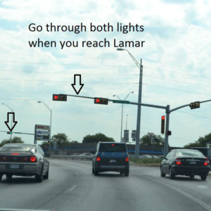 Go through both lights when you reach Lamar